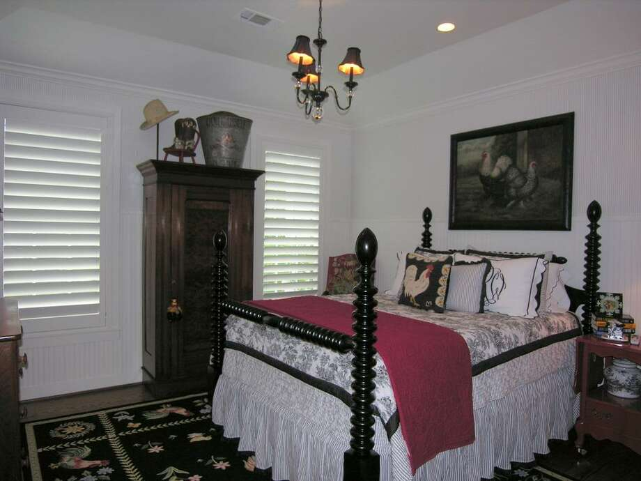 Downstairs secondary bedroom wing has 2 bedrooms with ensuite baths, red oak hardwood floors, vaulted trey ceilings, recessed lights and chandeliers,views to front, Clearview plantation shutters, walk-in closets with built-ins.