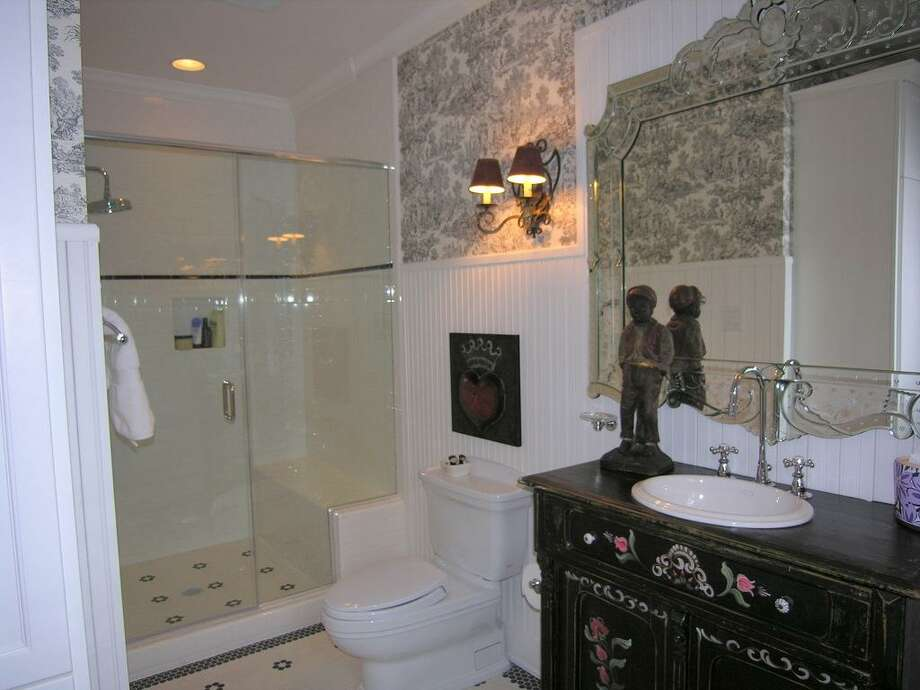 Both ensuite secondary baths downstairs have unique antique vanity with custom sinks, custom stone shower, tile flooring, custom mirrors, beadboard walls, Stainless fixtures by Water Works, sconce and recessed lighting, Clearview plantation shutters.