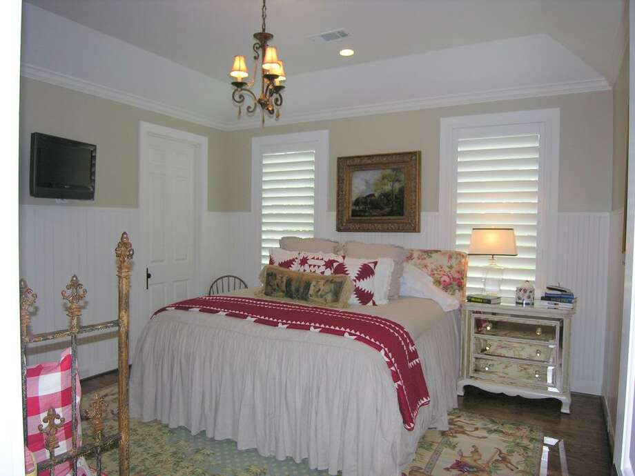 MAIN HOUSE - Another secondary ensuite bedroom downstairs with beadboard walls. Beautiful!