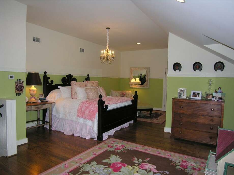 Fourth Bedroom Suite UPSTAIRS has red oak floor, window seating, chandelier and recessed light, California Closet finishes, bath with antique vanity with sink, large shower, penny tile floor by Ann Sacks, window box dormers, millwork with star trim.