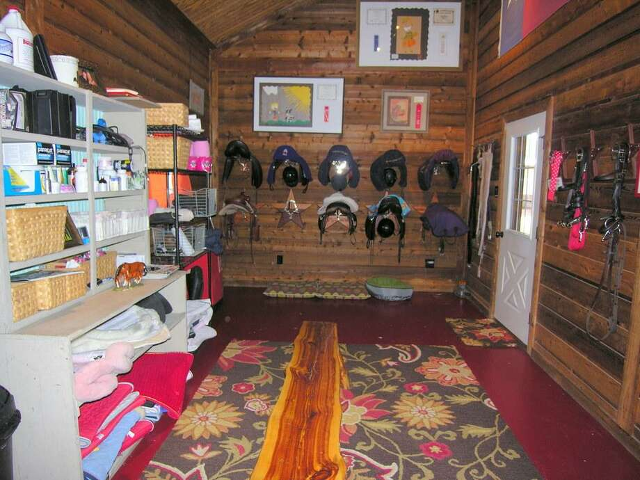 Large tack room in barn - Interior air conditioned rooms include viewing room to arena, office, 1/2 bath, large tack room and kitchen with sink, refrigerator/freezer, washer and dryer.