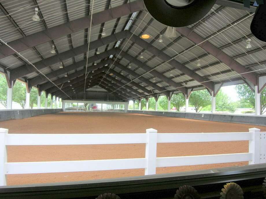 HUGE COVERED ARENA - Pic taken from inside viewing room - Olympic size (70' X 200'). Mirrored with sprinkler system & weight lifting gym rubber on walls. Footing recent (2012) GGT by Atwood Equestrian Surfaces. The BEST! Barn owl & chicks included.