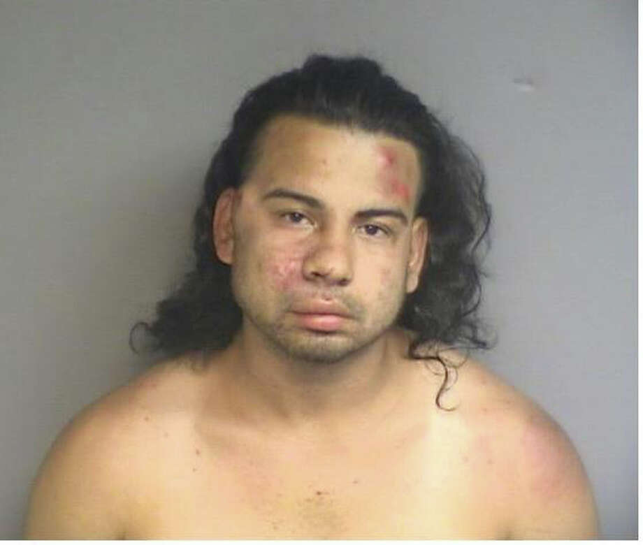 Charles Tapia, 26, of Mamaroneck, N.Y., was charged Thursday, June 27, 2013, with multiple drug charges after resisting arrest and allowing a vicious pit bull to attack three police officers. Photo: Contributed Photo