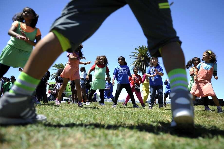 Children dance to salsa tought by Brenda Perdue.