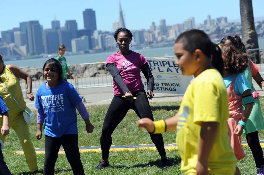 Olympian Gail Devers (center) dances salsa and zumba with children.