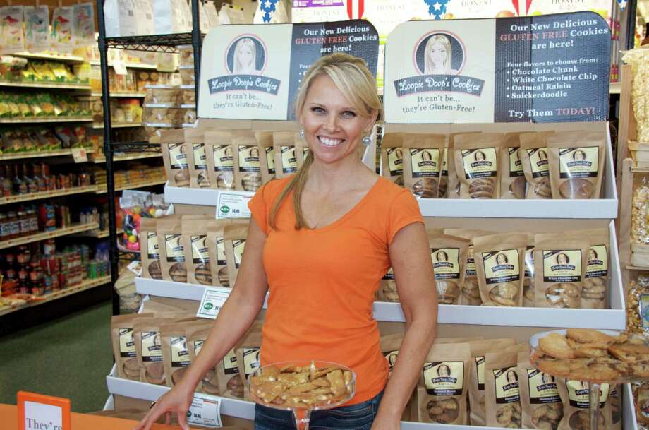 Lisa Najarian set up a demo for customers to try her new gluten free Loopie Doop's Cookies at Walter Stewart's Market on June 17, 2013 in New Canaan, Conn. Photo: Jeanna Petersen Shepard / New Canaan News Freelance