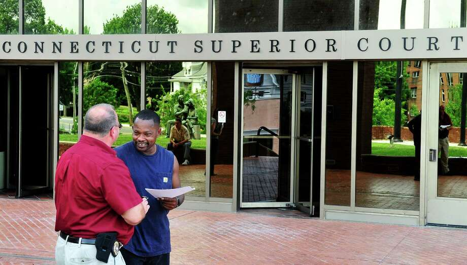 Connecticut State Marshal Rich DeLuca helps Charles Hill concerning a restraining order at the Superior Courthouse in Danbury, Conn. Friday, June 28, 2013. Photo: Michael Duffy / The News-Times