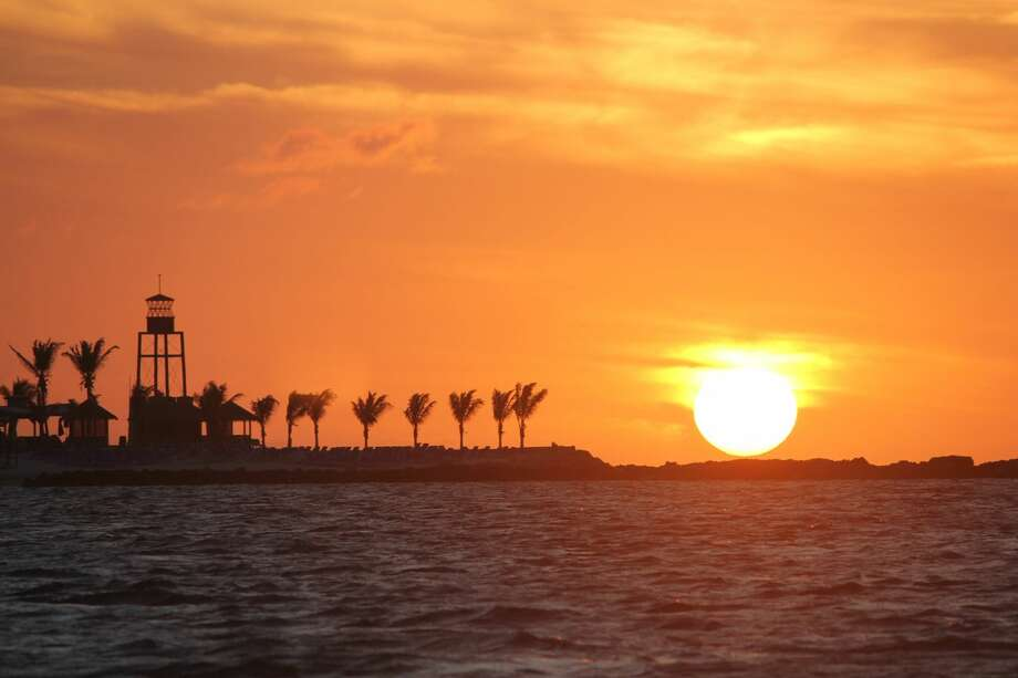 "The sun sets at West End, Grand Bahama Island, one of the stops on the Hardbergers' two-month trip on ""Aimless."" Photo: Special To The Express-News"