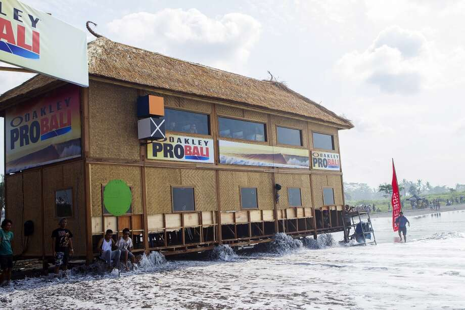 High tide floods the tower on June 25, 2013 in Denpasar, Bali, Indonesia.