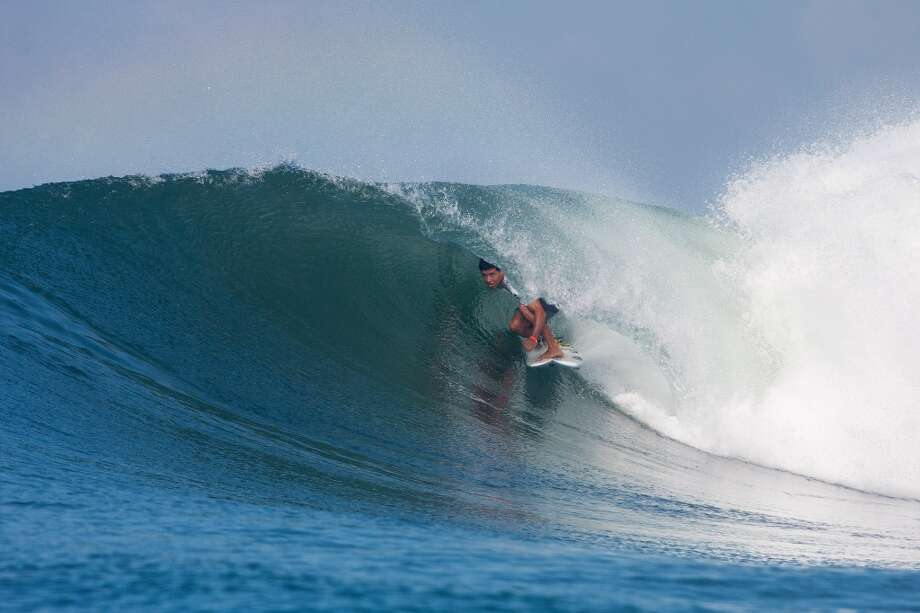 Adriano De Souza of Brasil surfs to an equal ninth place on June 26, 2013 in Denpasar, Bali, Indonesia.