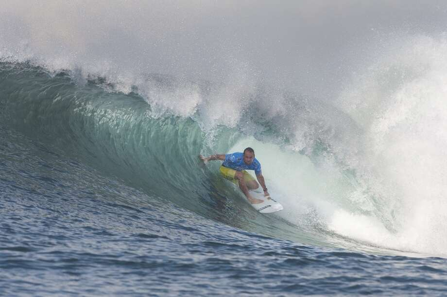 CJ Hobgood of the United States of America surfs to an equal fifth place on June 27, 2013 in Denpasar, Bali, Indonesia.