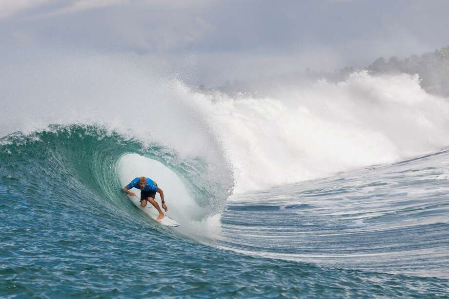 Mick Fanning of Australia surfs during the quarterfinals on June 27, 2013 in Denpasar, Bali, Indonesia.