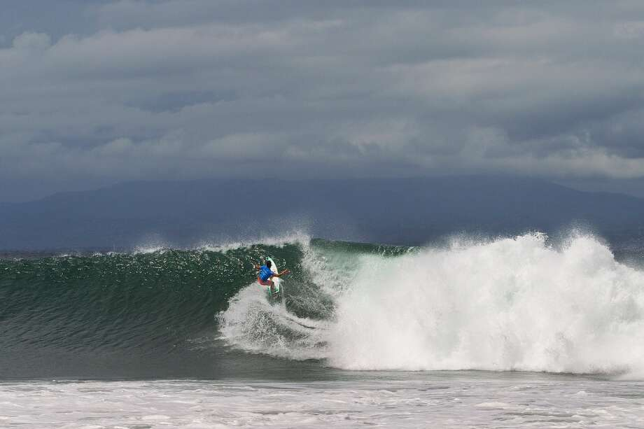 Michel Bourez of Tahiti surfs during the final on June 27, 2013 in Denpasar, Bali, Indonesia.