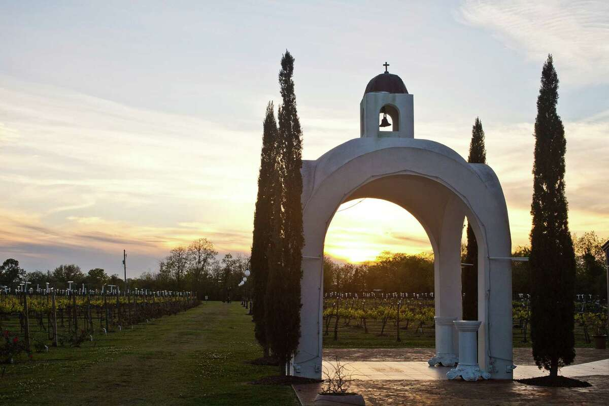 The sun sets over the Haak Winery's mission style structures, Friday, April 5, 2013, in Santa Fe. (Nick de la Torre / Houston Chronicle)