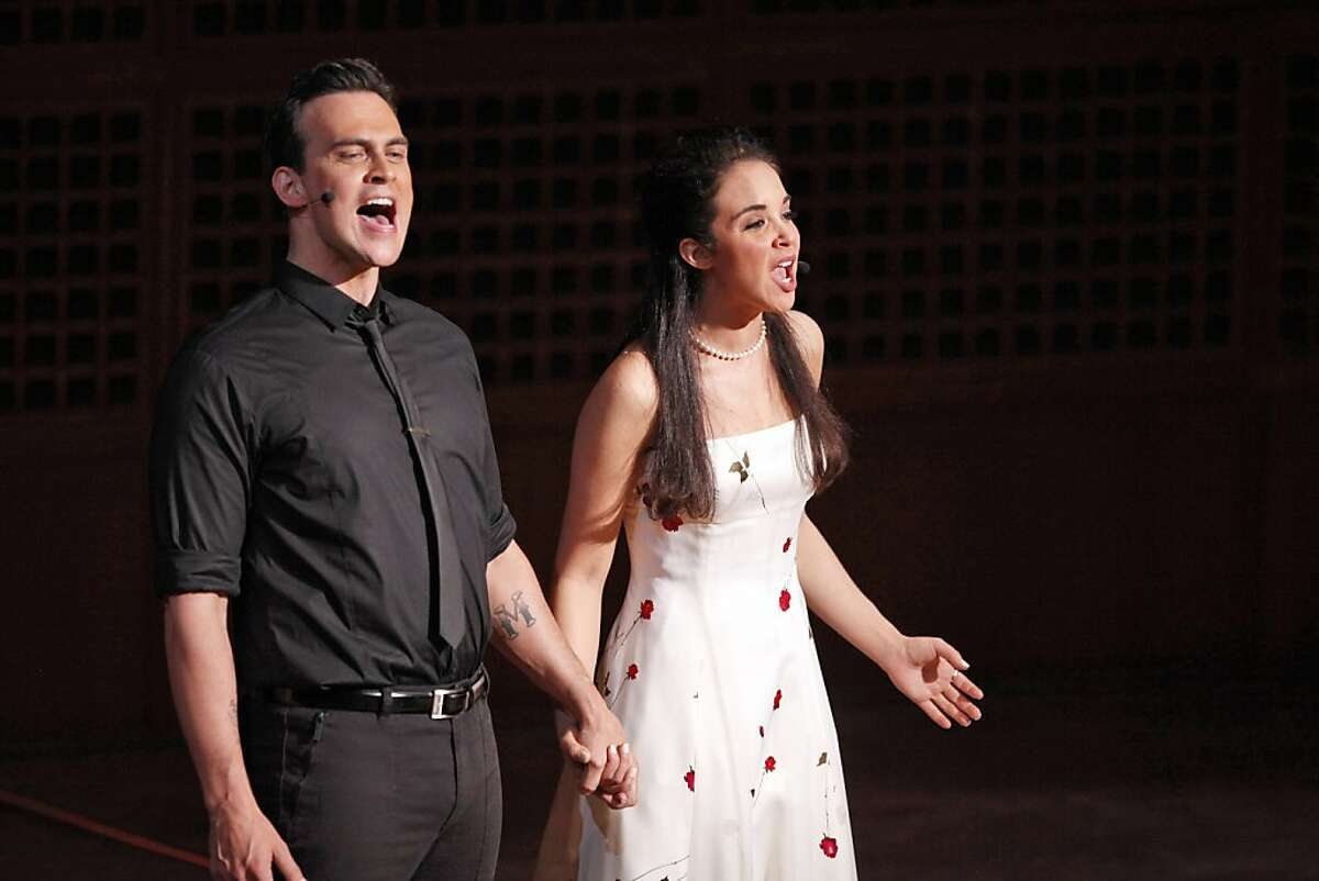 Alexandra Silber, right, as Maria, and Cheyenne Jackson, left, as Tony, in a performance of West Side Story led by Michael Tilson Thomas at the San Francisco Symphony on Thursday, June 27, 2013.