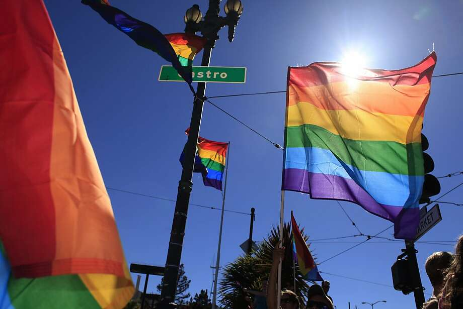 Rainbow flags fly in the Castro district, the heart of S.F.'s gay community. The Advocate ranked the city No. 11 on its list of the nation's gayest places. Photo: Mike Kepka, The Chronicle