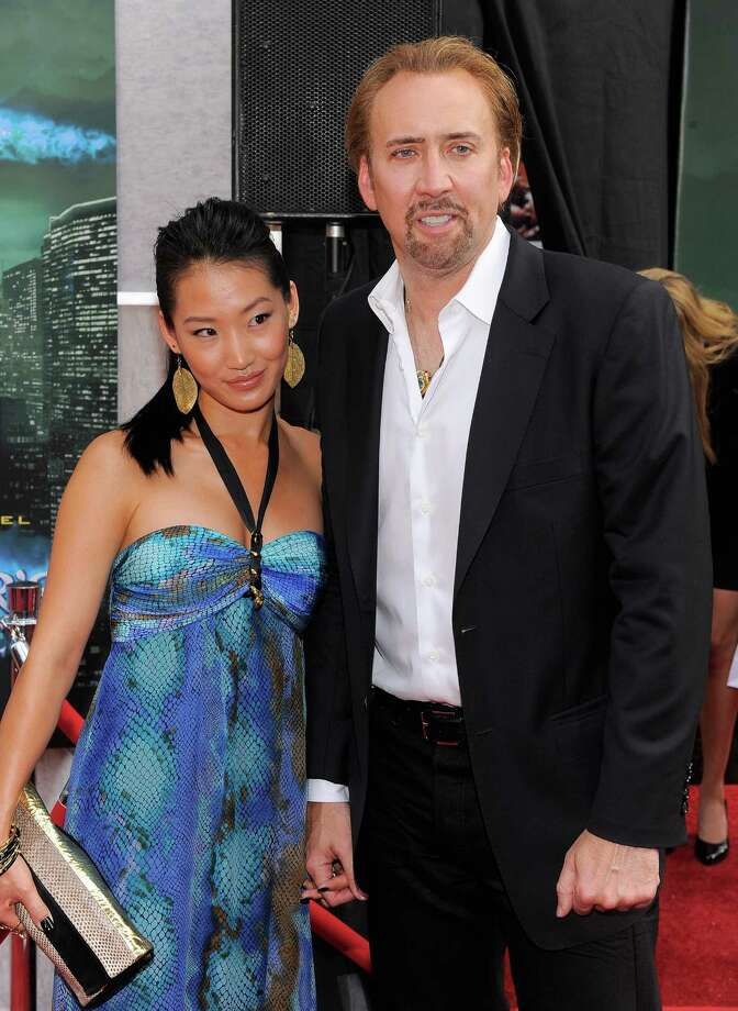 "Nicolas Cage, 51, and third wife, Alice Kim Cage, about 30, at ""The Sorcerer's Apprentice"" premiere in 2010. Photo: Jemal Countess, Getty Images / 2010 Getty Images"