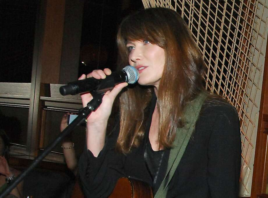 """Carla Bruni performs at the Hotel Royalton in New York. Her new album is """"Little French Songs."""" Photo: Owen Hoffmann, Associated Press"""