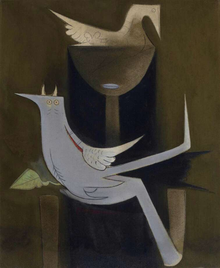 """On view in """"Intersecting Modalities: Latin American Art from The Brillembourg Capriles Collection"""" at the Museum of Fine Arts, Houston through Sept. 2: Wilfredo Lam's """"Woman with Bird"""" (1955, oil on canvas), The Brillembourg Capriles Collection of Latin American Art (c) 2013 Artists Rights Society (ARS), New York'ADAGP, Paris Photo: Artists Rights Society, New York"""