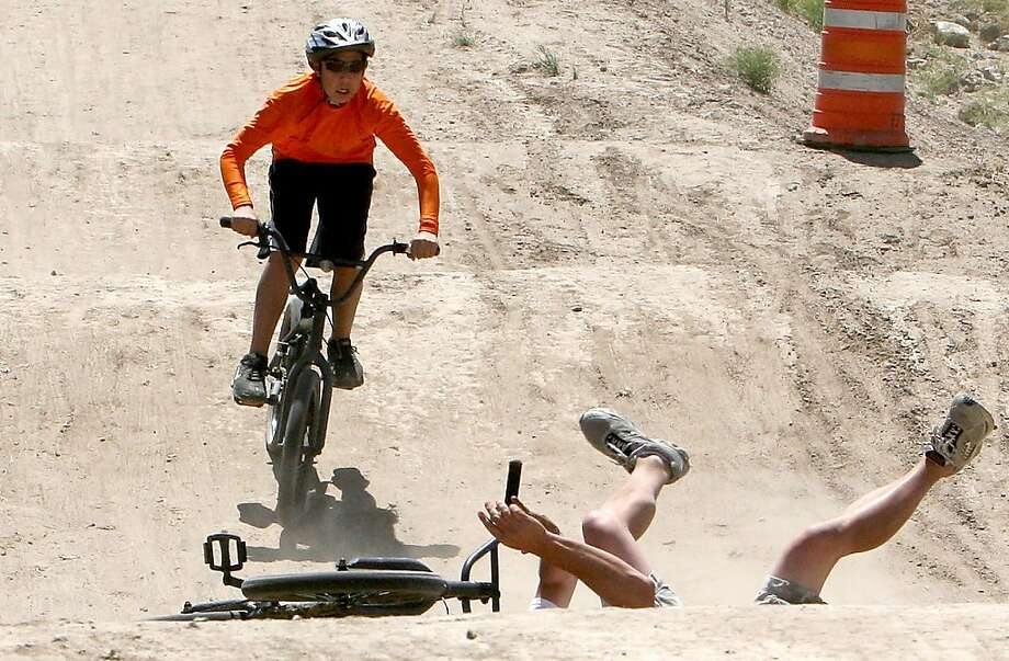 Fall-down Scout at Rise Up Camp: A BMX-ing Boy Scout has to react fast to avoid a wreck on the course near the Rise Up Scout 