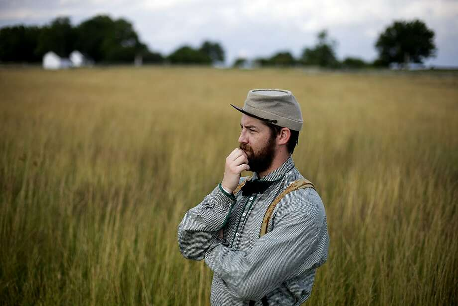 What was Lee thinking?! Confederate reenactor Tripp McMillan of the 9th Texas Infantry ponders the sprawling field at Gettysburg where Pickett's division charged the Union center with disastrous results. Photo: Matt Rourke, Associated Press