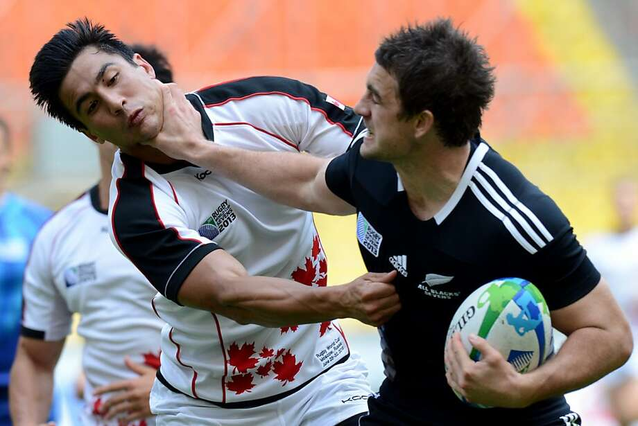 Wring around the collar: New Zealand's Kurt Baker nearly throttles Canada's Nathan Hirayama during a Rugby World Cup Sevens match in Moscow. Photo: Kirill Kudryavtsev, AFP/Getty Images