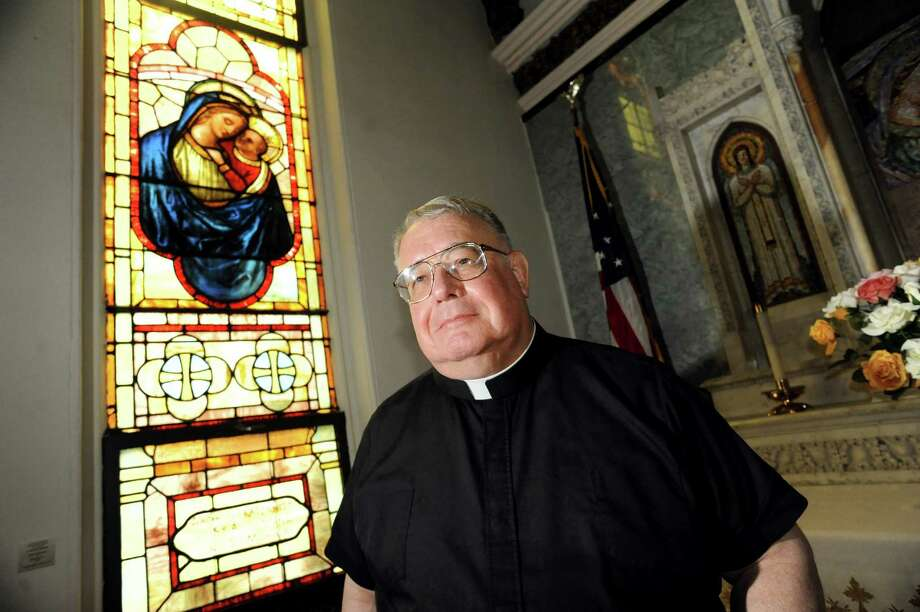 Father Jim Spenard on Wednesday, June 26, 2013, at St Augustine's Catholic Church in Lansingburgh, N.Y. (Cindy Schultz / Times Union) Photo: Cindy Schultz / 00022964A
