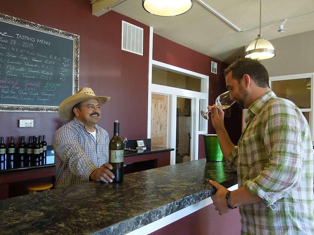Ulises Valdez of Valdez Family Winery and tasting room pours for a customer in the tasting room in Healdsburg, Calif.