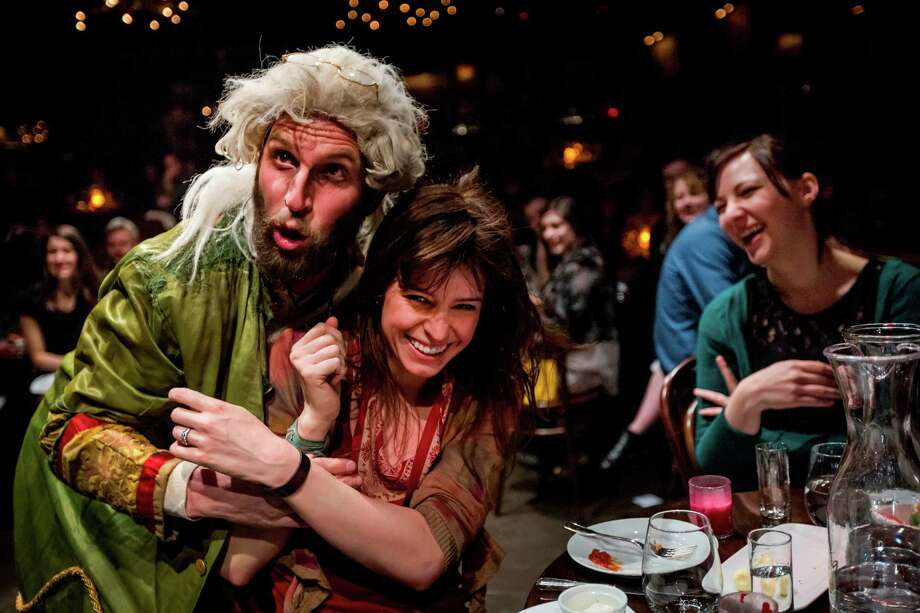 """Blake DeLong interacts with the audience attending """"Natasha, Pierre and the Great Comet of 1812."""" The musical/dinner-theater concept is attracting a younger crowd than those attending Broadway shows. Photo: Chad Batka"""