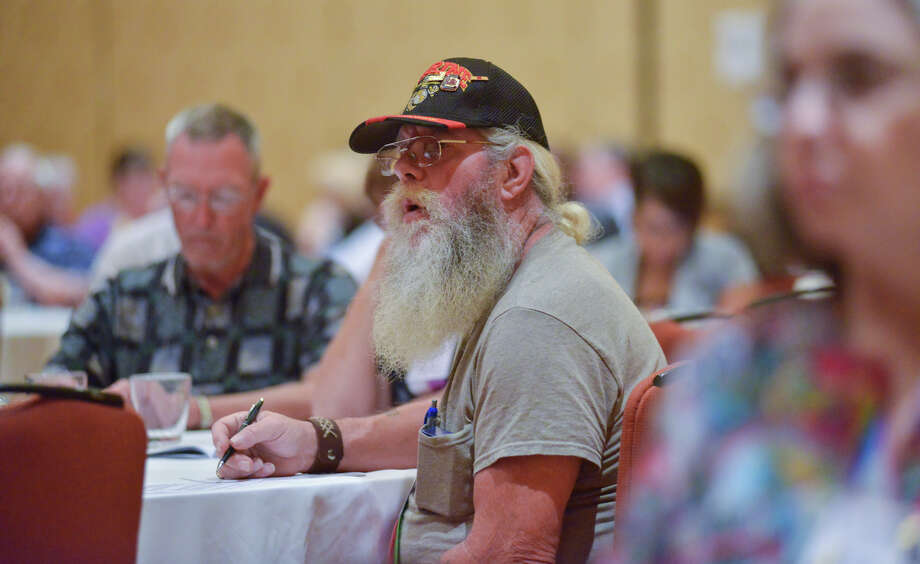 Donald Miner of Columbia SC, listens to a panel discussion on Faith, Family, and Recovery during the National Alliance of Mental Health Conference Friday at the Grand Hyatt. Photo: Robin Jerstad