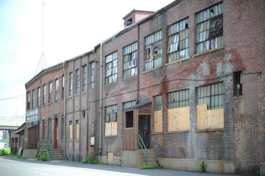 The former Chromium Process Co. building on Canal Street in Shelton, Conn. The city of Shelton plans to demolish it to make room for parking and a road that will take traffic off Howe Avenue to ease congestion. Photo: Autumn Driscoll / Connecticut Post