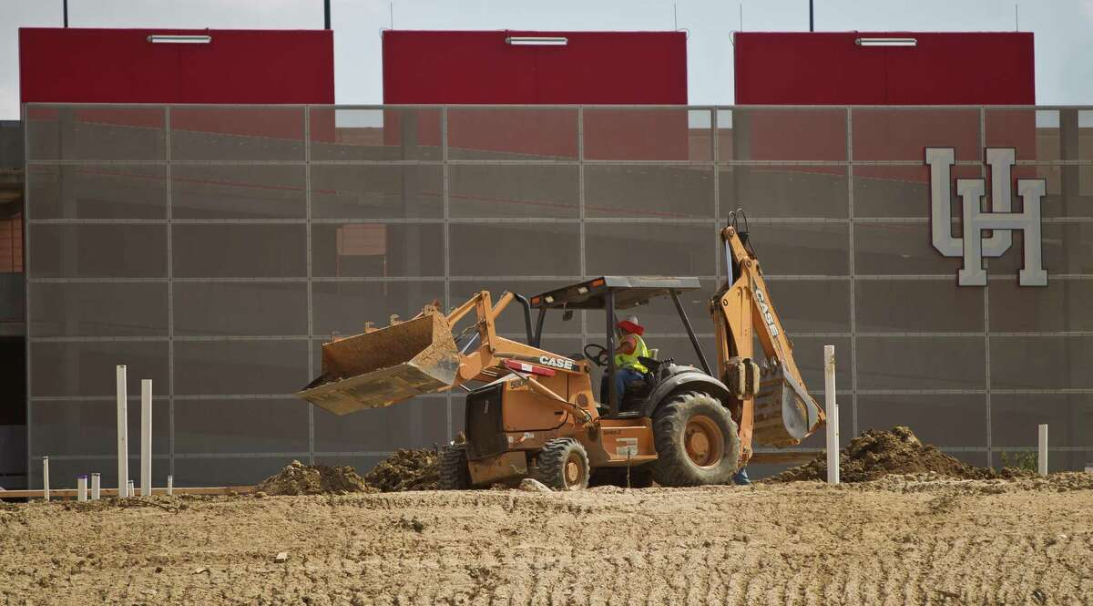 Manhattan construction crews work on the University of Houston's new on-campus stadium, Tuesday, June 25, 2013, in Houston.