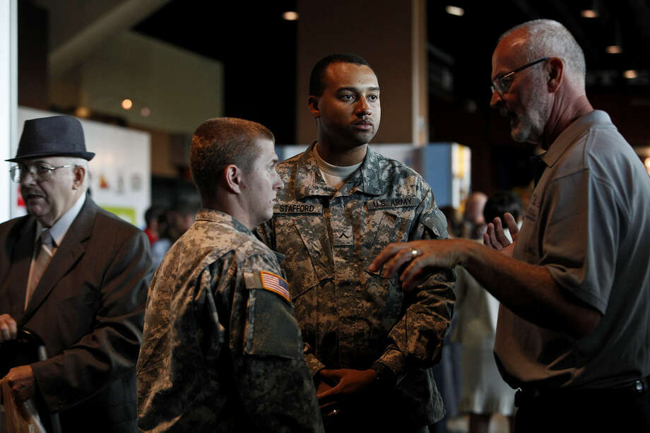 Pvt.  Cory Nicol (left) and Pvt. Jonathan Stafford (center), both in the National Guard, attend the Recruit Military Veteran job fair last year. Manufacturing and veterans may be the perfect match. Photo: File Photo, San Antonio Express-News