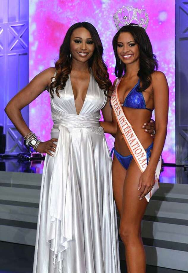 Model and pageant judge Cynthia Bailey and Marissa Raisor of Newport, Kentucky pose onstage after Raisor was crowned Miss Hooters International 2013. Photo: Ethan Miller, Getty Images / 2013 Getty Images