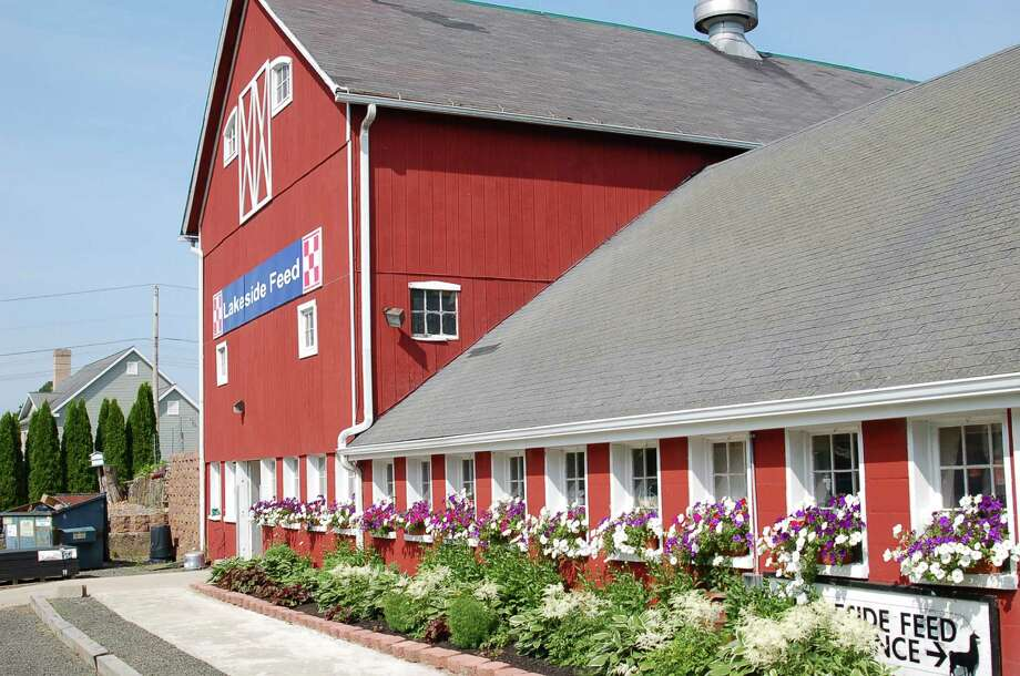 At Lakeside Feed, a large farm in Guilford, is this English-style barn, decorated with flower boxes, as is a nearby farm house. Photo: DAVID W. KEYES/STAFF PHOTO