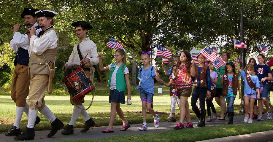 "Kids proudly wave their American Flags as they participate in American Election Day events at Bayou Bend on Sunday, Nov. 4, 2012, in Houston. The event was designed to teach the American democratic process to youngsters with historic re-creations, including a live 19th-century-style debate, re-enactors, and a chance to practice voting using the ""bean & corn"" method that was common in the early days of the country.   ( J. Patric Schneider / For the Chronicle ) Photo: J. Patric Schneider, Freelance / © 2012 Houston Chronicle"