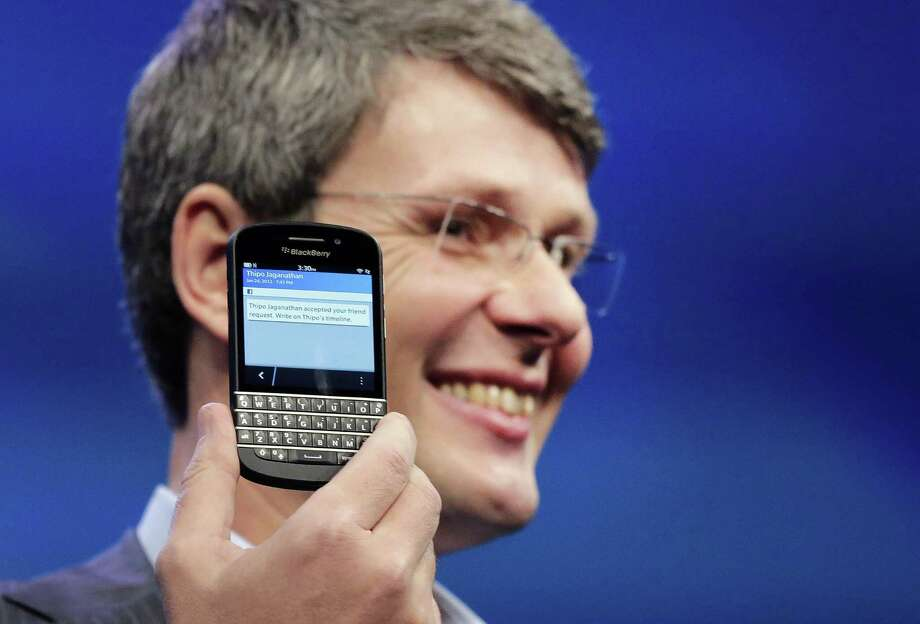 A cheerful Thorsten Heins, CEO of BlackBerry, in January introduced the BlackBerry Z10. On Friday, BlackBerry's losses sent its shares plunging. Photo: Mark Lennihan, STF / AP
