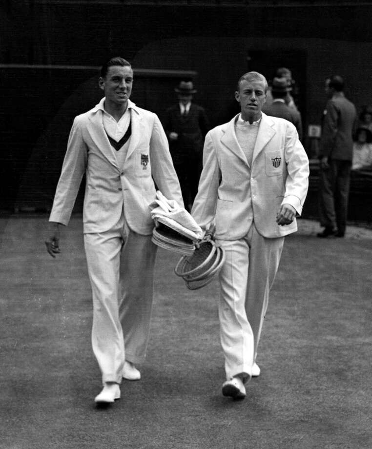 June 1931 — Looking classically preppy, English tennis player Fred Perry and his opponent walk onto the court before their Wimbledon Lawn tennis Championship match.