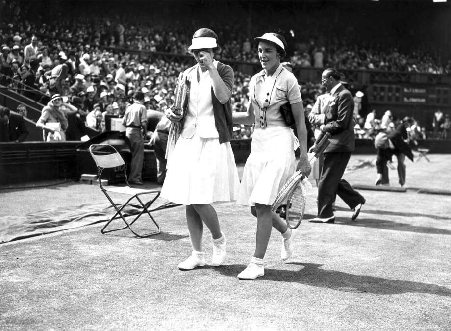 July 1935 —  Helen Wills Moody and Joan Hartigan at Wimbledon. Helen Wills Moody (left) dominated women's tennis from 1926 until the outbreak of World War II. She won eight singles finals at Wimbledon and seven US championships.