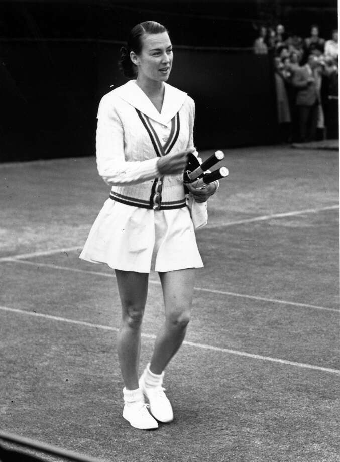 July 1950 —  American tennis star Gertrude 'Gussie' Moran arriving on Court No. 3 at Wimbledon for her match with Mrs. W. Halford.