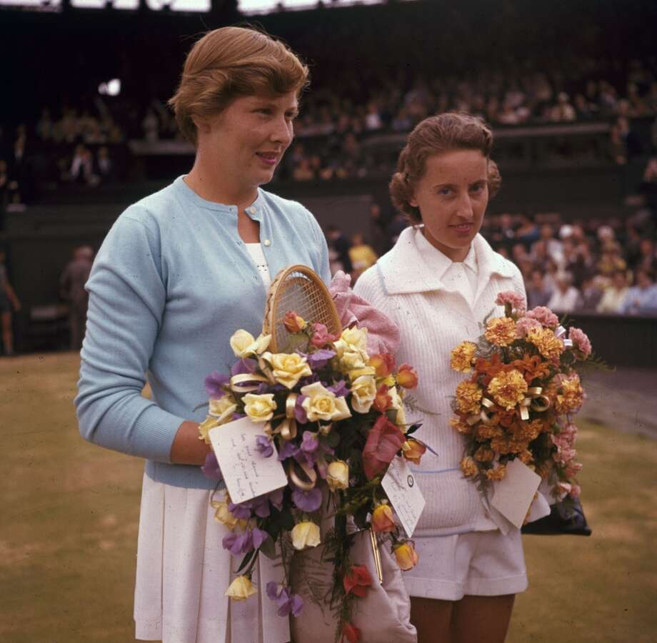 July 1961 —  British tennis player Angela Mortimer with Christine Truman (left), after winning the women's single final at the Wimbledon Lawn Tennis Championships.  Their cardigans are very demure.