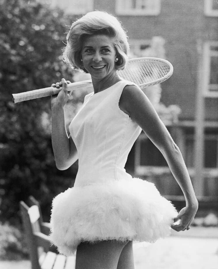 June 1964 —  Italian tennis star Lea Pericoli wearing a tennis dress trimmed with feathers, designed by British sportswear designer Teddy Tinling.