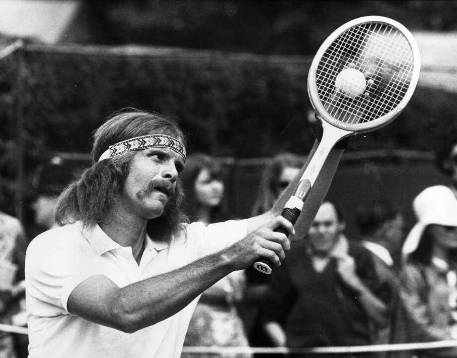 June 1971 —  South African tennis player Ray Moore preparing to serve at the Wimbledon Tennis Championships. Unconfirmed whether or not he went on to sing ''Spirit in the Sky.''