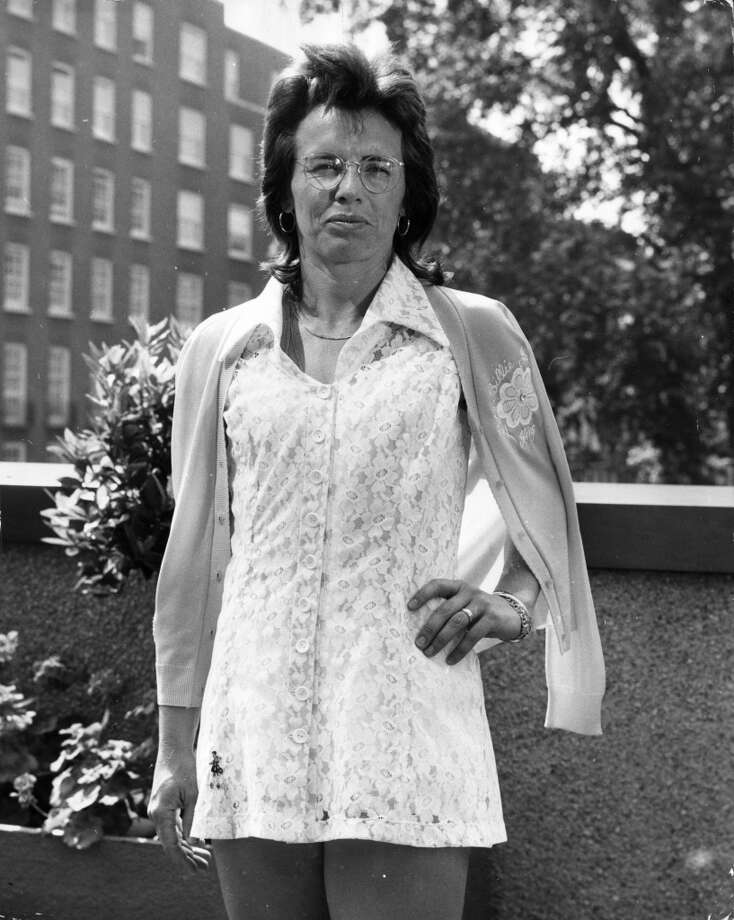 June 1974 — Billie Jean King sporting her latest Wimbledon tennis dress, a white lace creation by Teddy Tinling, at a pre-match press photocall in Knightsbridge, London.
