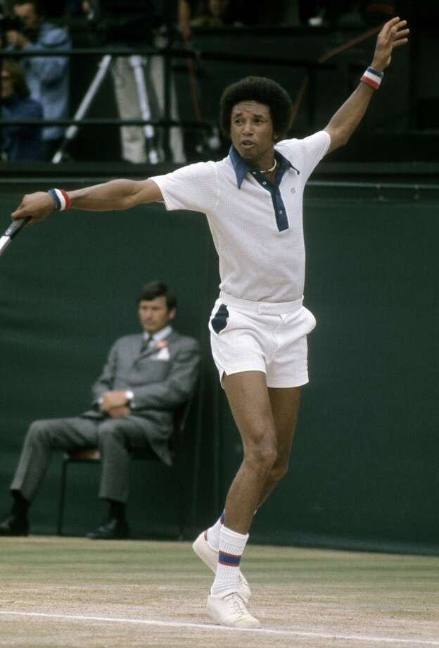 July 1975 — Arthur Ashe plays a backhand against his opponent during the men's singles play of the Wimbledon Lawn Tennis Championships.