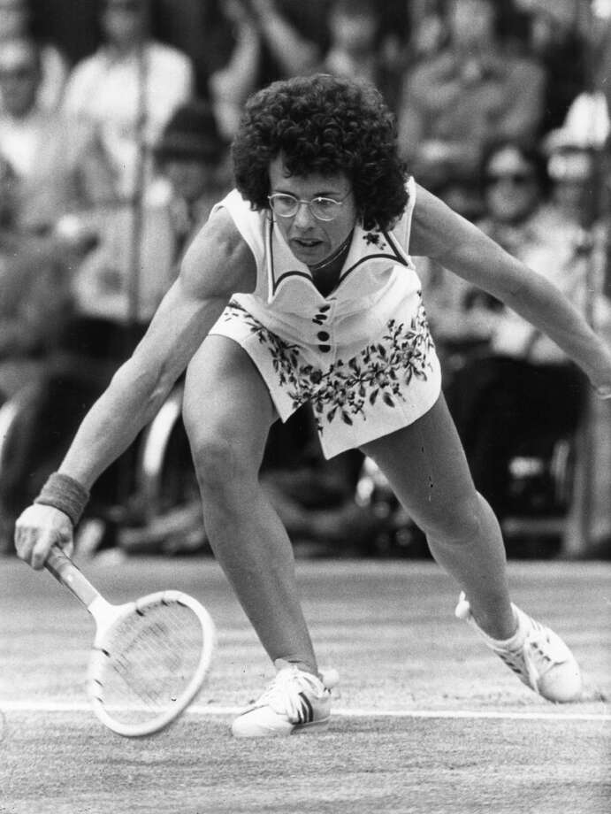 July 1975 —  Billie Jean King bends for a low ball during a match at the Wimbledon Tennis Championships. She went on to win her sixth women's singles title, beating Evonne Cawley in the final.