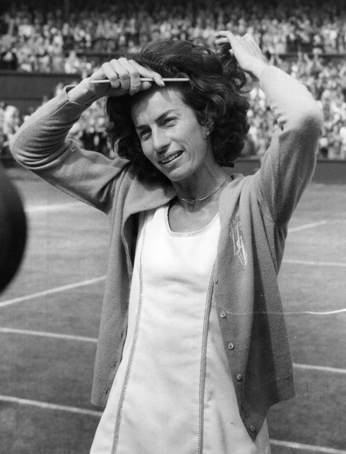 July 1977 — British tennis player Virginia Wade combs her hair as she prepares to meet the Queen after her victory in the Women's Singles Final at Wimbledon. She beat the Dutch player, Betty Stove.