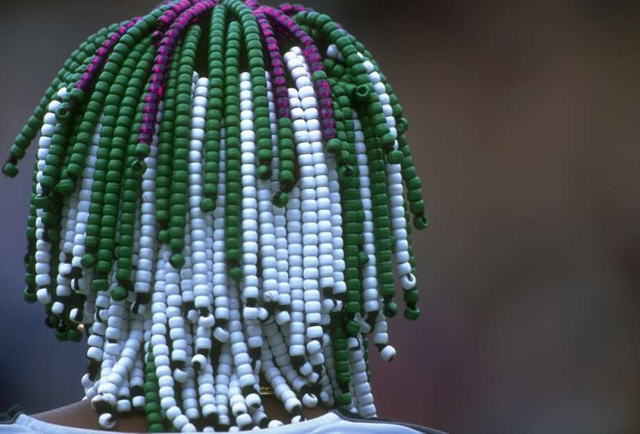 June 1997 —  Rear view of Venus Williams' signature beaded hair  during her match against Magdalena Grzybowska of Poland at the Lawn Tennis Championships at Wimbledon in London.