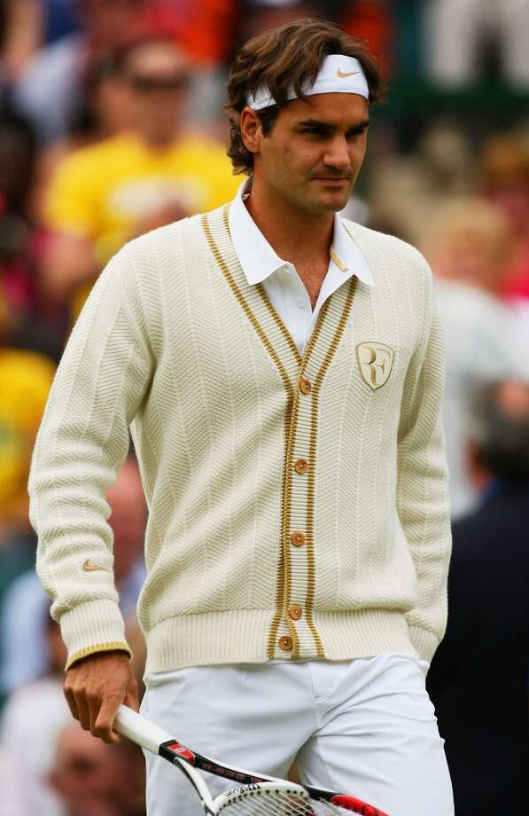 June 2008 —  Roger Federer of Switzerland arrives on court in a sweater that wouldn't be out of place on our 1950s tennis players.