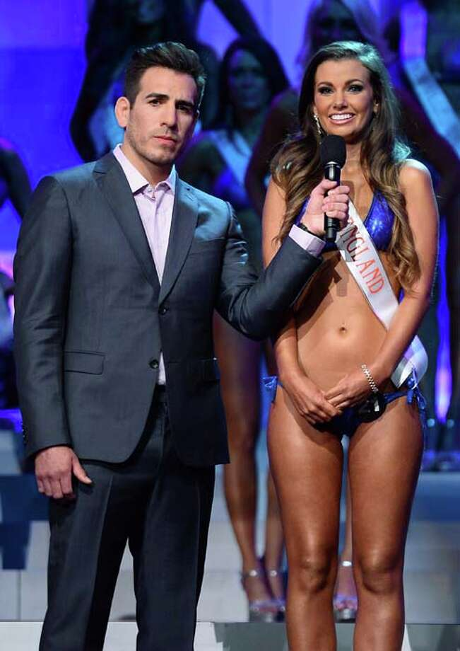 Co-host and former mixed martial artist Kenny Florian holds a microphone as Lydia Hipkiss of England answers a question Photo: Ethan Miller, Getty Images / 2013 Getty Images